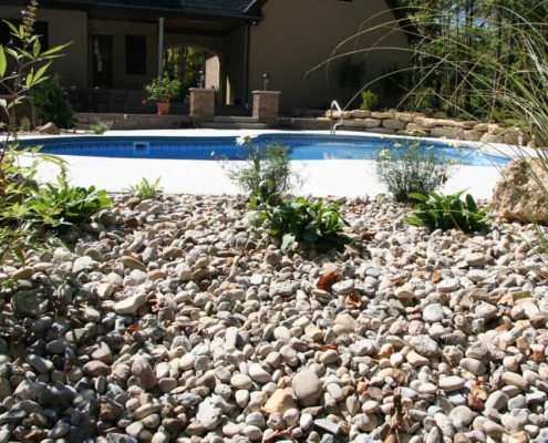 stones next to a swimming pool