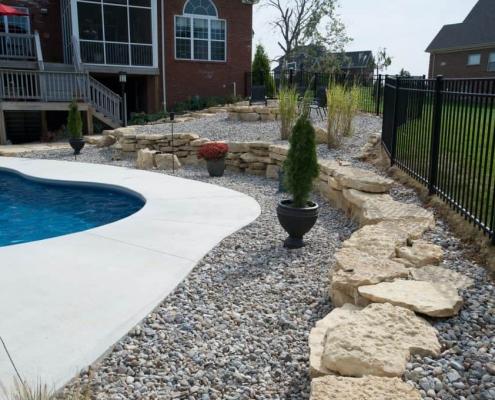 Stone features around a inground pool