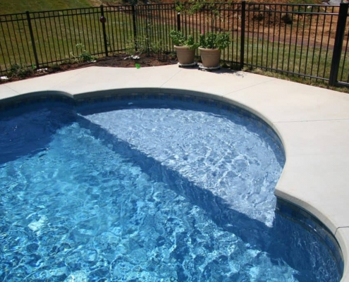 a sitting area in a pool