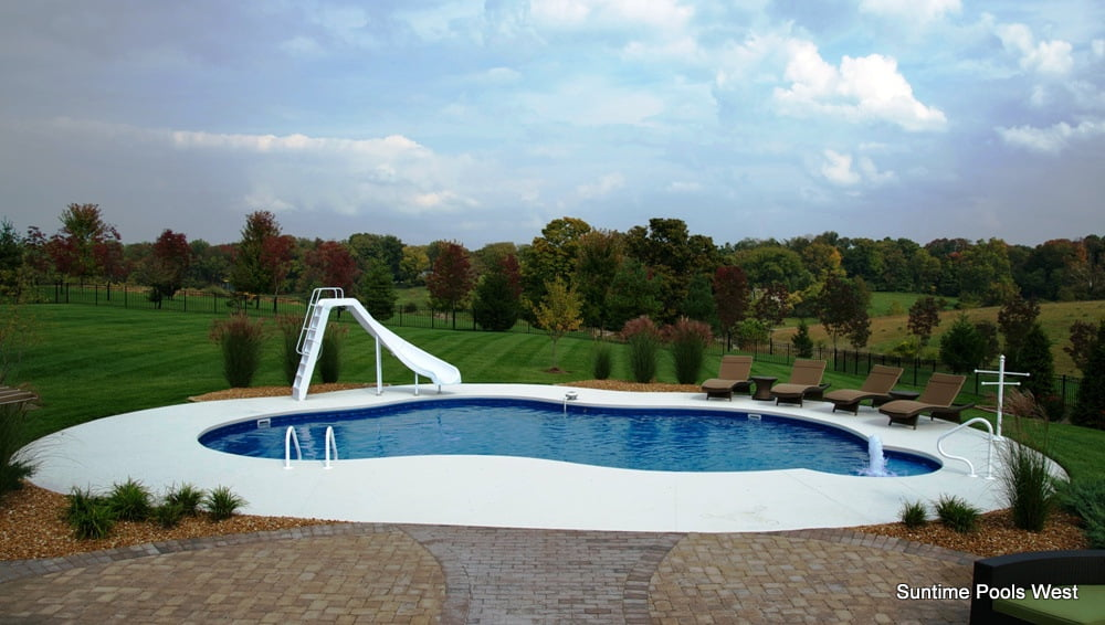 A high-quality free-form inground pool with slide and fountain